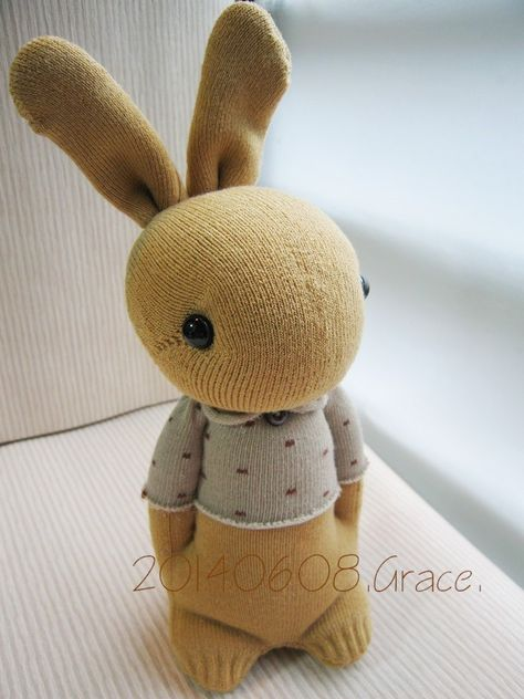 sock rabbit  after stuffing the body, pinch the sides of the body where the arms…