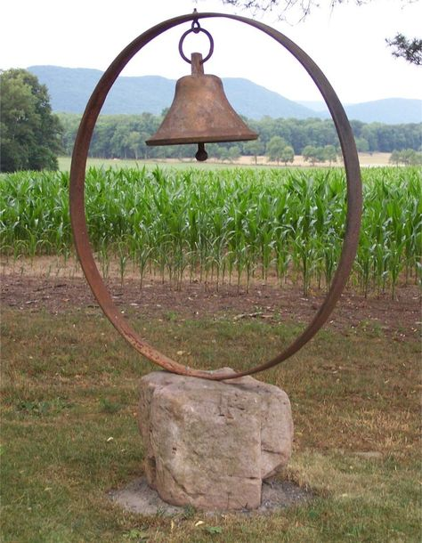 Iron bell/wagon wheel. Creative mind and work of George Weaver of Rote, Pennsylvania...love everything about it. ..via Flea Market Gardening. I have the wheel.