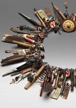 Necklace by Susan Lenart Kazmer- Includes feathers, coils, pencil ends.