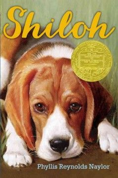 1992- Shiloh by Phyllis Reynolds Naylor - When he finds a lost beagle in the hills behind his West Virginia home, Marty tries to hide it from his family and the dog's real owner, a mean-spirited man known to shoot deer out of season and to mistreat his dogs.
