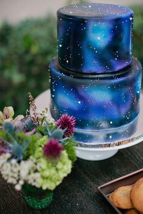 Space Guide The Cake: Merely Sweets crafted the galaxy cake, giving it a tie-dye feel. Source: Richelle Dante Photography - Merely Sweets crafted the galaxy cake, giving it a tie-dye feel.