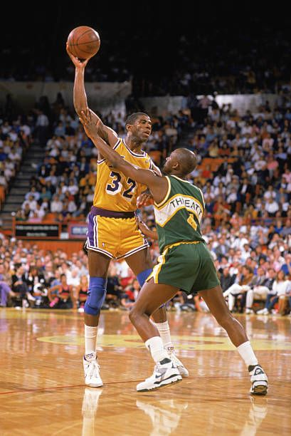 Magic Johnson Of The Los Angeles Lakers Holds The Ball Over Sedale Magic Johnson Los Angeles Lakers Magic Johnson Lakers