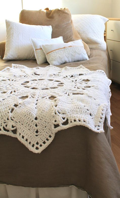 love crocheted throw. I think it's originally supposed to be a round tablecloth. I have a couple of these & think using as a throw is a great idea! #crochet