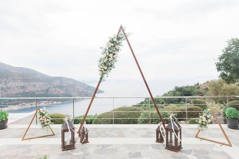 """A triangle shaped wedding arch will definitely make your ceremony unforgettable as it's striking and refined…"""" • Lefkada Wedding Planner Lefkas Weddings • See 873 photos and videos on their profile."""
