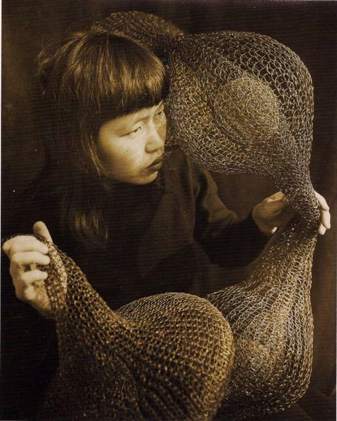 ericatanov:    ruth asawa holding a form-within-form sculpture  1952  photograph by imogen cunningham