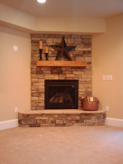 The Basement Company Basement Design Finishing Remodeling In - Stone corner fireplace pictures