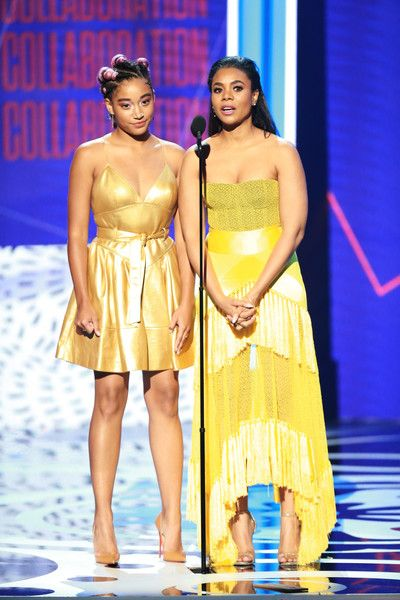 Amandla Stenberg (L) and Regina Hall speak onstage at the 2018 BET Awards at Microsoft Theater.