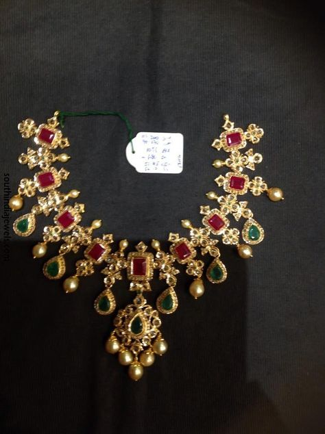 Gold CZ stone necklace embellished with square rubies, tear shaped emeralds and pearls