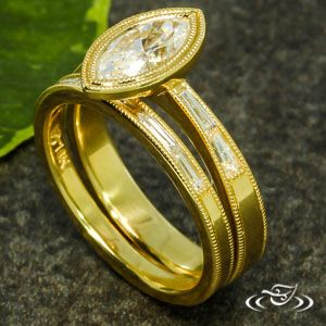My wedding band set in yellow gold marquise diamond wedding band set by Melissa at Greenlake Jewelers in Seattle. The best custom work! Amazing online communication and beautiful craftsmanship.