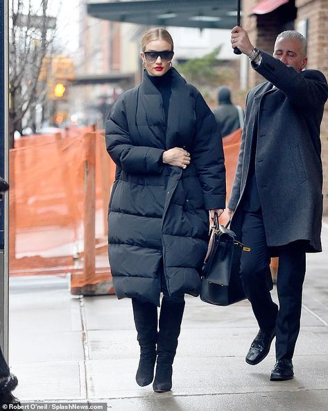 Rosie Huntington-Whiteley cuts an elegant figure as she braves rainy weather on day out in New York