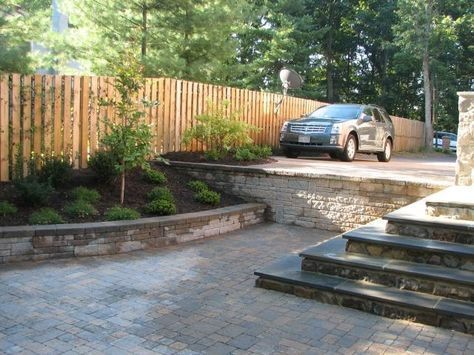 more sturdy-looking stone retaining wall.  I also like the semi-private fence here.
