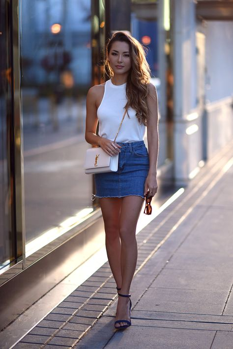 A denim mini skirt will look effortlessly stylish when paired with a simple white vest or tee. This is a classic style which will never go out of fashion! Via Jessica R. Top: Urban Outfitters, Skirt: Nordstrom, Bag: YSL, Heels: Schutz.