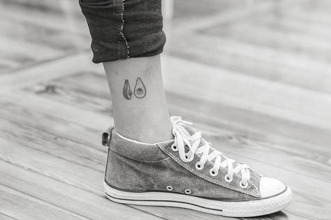 Hand poked avocado tattoo on the ankle.