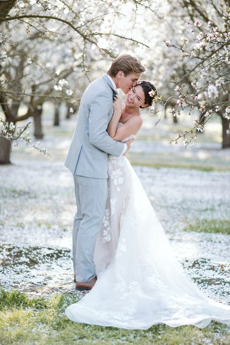 Whimsical Almond Orchard Blossom Wedding Inspiration – Playful Soul Photography 32  Blossoming orchards are the perfect backdrop for a nature-filled outdoor celebration.  A sweet kiss is shared between the couple at the orchard.  #bridalmusings #bmloves #wedding #weddinginspo #weddinginspiration #blossom #orchard #outdoorwedding