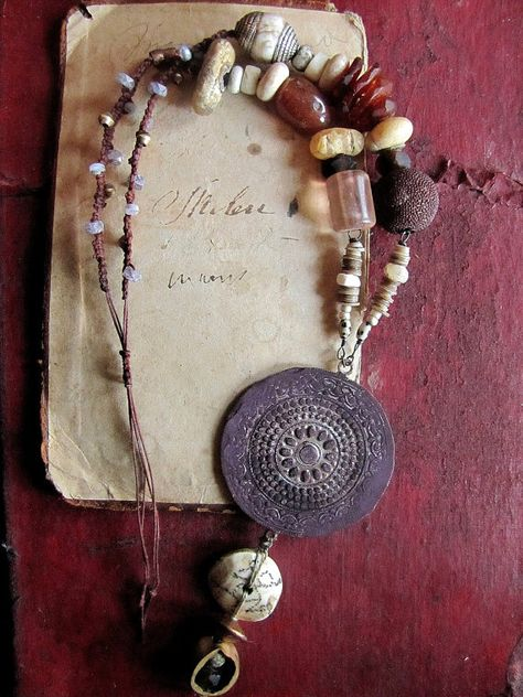 ad lucem medallion talisman by ekstertera - vintage silver medallion, hammered and rubbed with a deep purple coloured wax, antique tibetan chank shell pendant with an inscribed figure