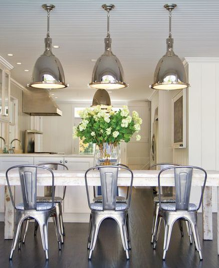 metal tolix chairs with chrome light fixtures // east hamptons beach house