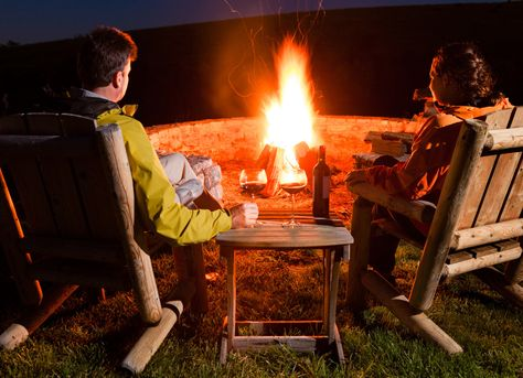 couple enjoying bonfire at backyard
