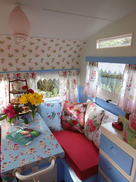 An angel in the garden: Lucy, Our Sweet Vintage Caravan