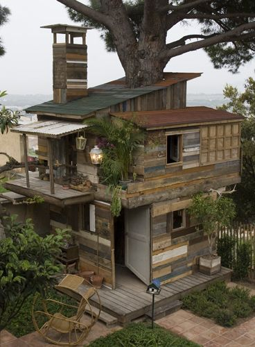 Recyled items that have been made into a tree house.  If he's anything like me, He'll love it....