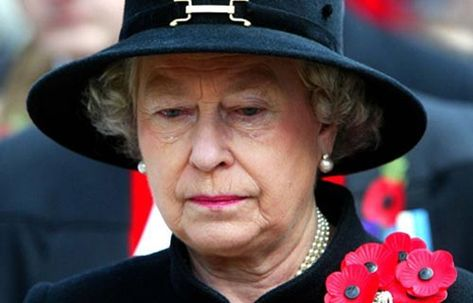 Photo taken by Jeremy Selwyn in November 2002. This image shows a visibly moved Queen Elizabeth II as she takes over the role of her late mother, The Queen Motherm at The Annual Field Of Remembrance Service At Westminster Abbey in London. It held significance for being one of the only times The Queen has been captured crying on camera.