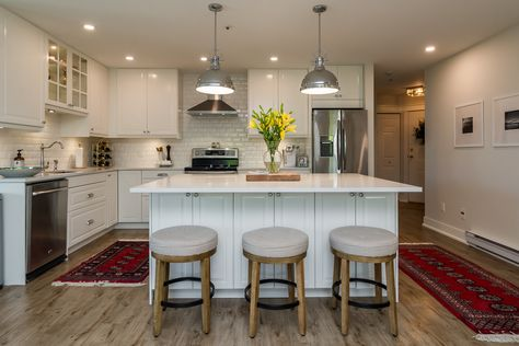 White IKEA kitchen with Island in condo - design by Christie Timperley