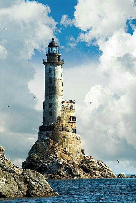 Ever wondered what a beautiful love story is that of a lighthouse and a sea? The lighthouse, Tall and statuesque, looks over the sea. And the mighty sea in all her glory swooshes around him. Lighthouse Painting, Lighthouse Pictures, Water Tower, Belle Photo, Beautiful Landscapes, Beautiful Places, Scenery, Around The Worlds, Ocean