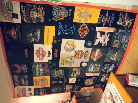 This is a quilt my mom and I made for my husband out of his old Harley t-shirts, ball cap patches, koozies, and the tags in the collars of some of the shirts. After it was pieced together, I pinned it onto a quilting machine and went around the bar-and-shield emblem on each shirt and the outline of the different designs on them. It looks great - we are so proud.