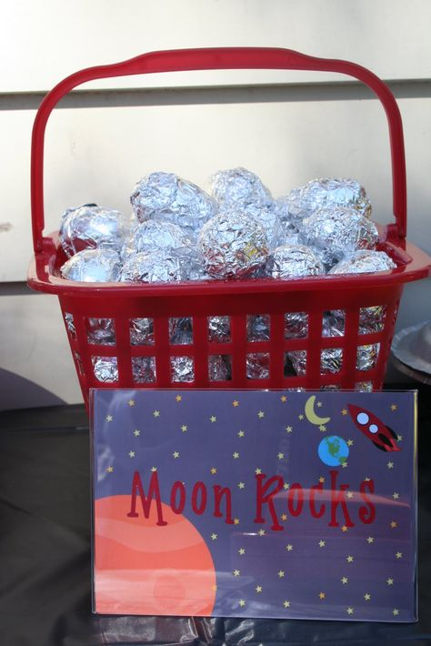 Treasure Hunt Game: Moon Rocks.  Plastic  Easter eggs wrapped in foil filled with rocket ship gummies and space stickers! Or you could fill with facts about space and planets.