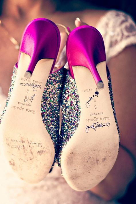 Bridesmaids signed the bottom of the bride's shoes.