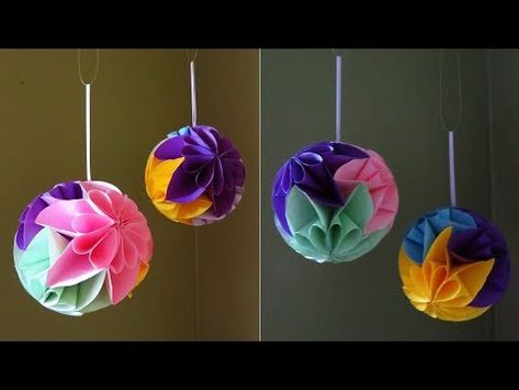 """Star Flower Ball : I have been asking a question about paper flower balls. Most of them which are made in an origami style rarely appear as a real sphere. I stumbled into a method for making star flowers and realised I could assembled them into a """"round"""" sphere. The..."""