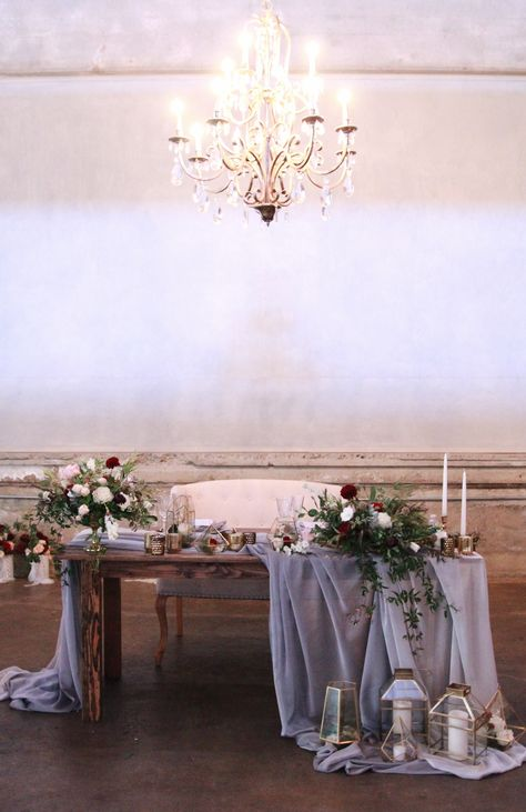 Industrial romantic wedding. Sweetheart table. Burgundy blush centerpieces.