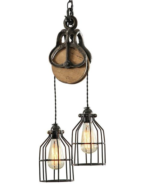 West Ninth Vintage pulley lights use a combination of industrial and rustic pulleys to create statement lighting for the home. Pulley lights work well as centerpiece lighting in living rooms and kitchens. Rustic Farmhouse Style, Vintage Lighting, Decor, Industrial Wood, Pulley Light, Rustic Lighting, Light, Steel Barns, Adjustable Lighting