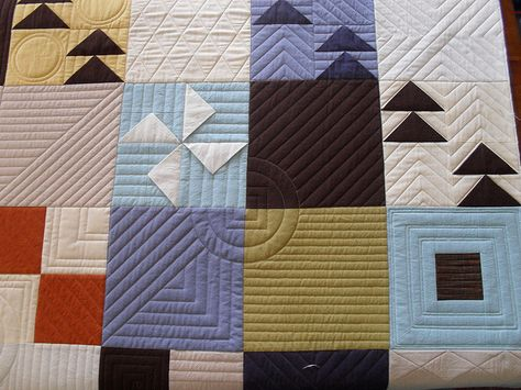 Love all the different straight lines in different directions with circles. Gives amazing texture and makes the quilt super fun.