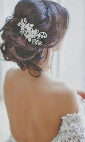 Romantic Bridal Updos // Classic bride wedding hair inspiration with pouf crown, big curls and a statement hairpiece. //  // #wedding #weddingday #weddinghairstyles #weddinghair #weddinghairstylesupdo #bridalbeauty #bridalhair #bride #bridalhairstyle #bridalupdo #romantichairstyles #messybun #chignon