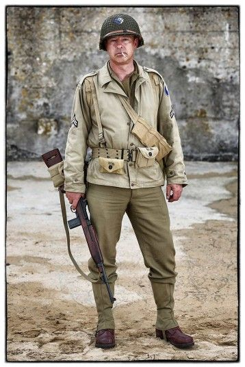 Martin Elford, from the United Kingdom, wears a replica uniform of a member of the US Army 29th Infantry Division