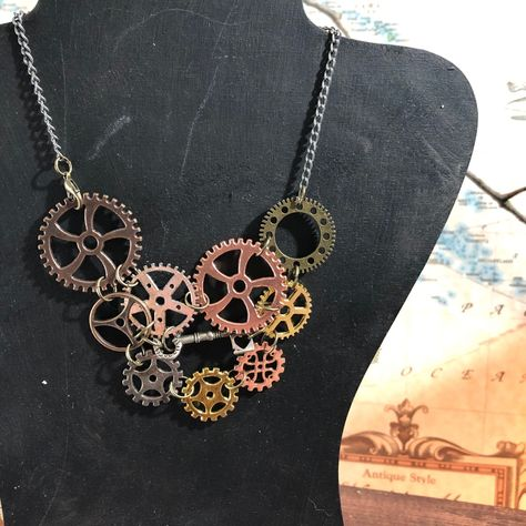 Every bit and bobble on this one of a kind necklace by our Chainmailler Denise is made of a lightweight metal, from the gears to the rings. There's enough shiny mechanical goodness on this Steampunk-inspired jewelry to make the heart of any gnome or artificer of any of the races flutter and skip a beat, beautifully assembled without a hint of actual practical use. While this might irritate those of more logical mindsets, the artistry makes the rest of us quite happy. This is an individual, handm