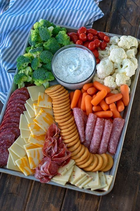 How to make a Sheet Pan Snack Platter for a hungry crowdYou can find Snacks for party and more on our website.How to make a Sheet Pan Snack Platter for a hungry crowd Snack Platter, Party Food Platters, Snack Trays, Crudite Platter Ideas, Hummus Platter, Snacks Dishes, Meat Platter, Cheese Party Trays, Simple Cheese Platter