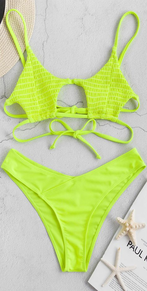 Stand out from the crowd in this neon bikini set. The bikini top is complete with a smocked body, cutout front, and duo tying back straps, as well as a pair of greatly shaped bottoms to accentuate that booty.