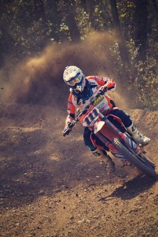 A Man Riding A Dirt Bike Racing Event On Very Fast Track Racing Bikes Dirt Bike Dirt Bike Racing