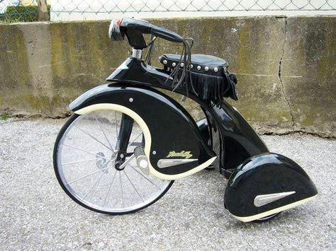 Harley tricycle; companies need to remember to play with products & ideas. This vintage tricycle is similar to pixar shorts. Play time is even more important for an adult.
