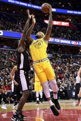 P Golden State Warriors Center Demarcus Cousins 0 Shoots Over Washington Wizards Center Thomas Bryant Left Nba Basketball Game Basketball Game Outfit Nba