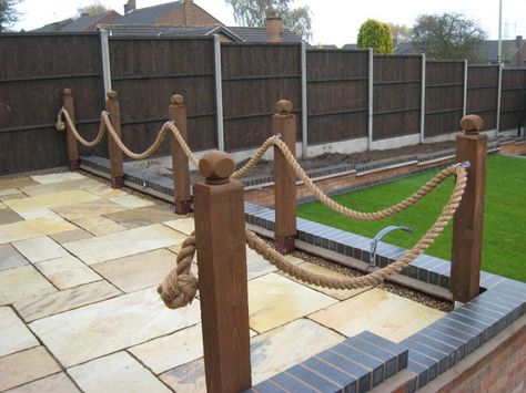 Some rope fencing decorating the edge of a patio.