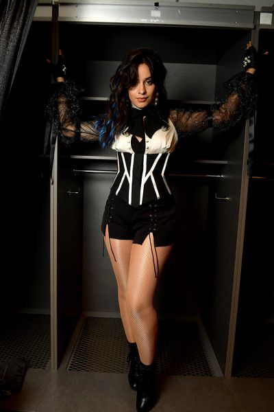 Camila Cabello poses backstage at AT&T Stadium.