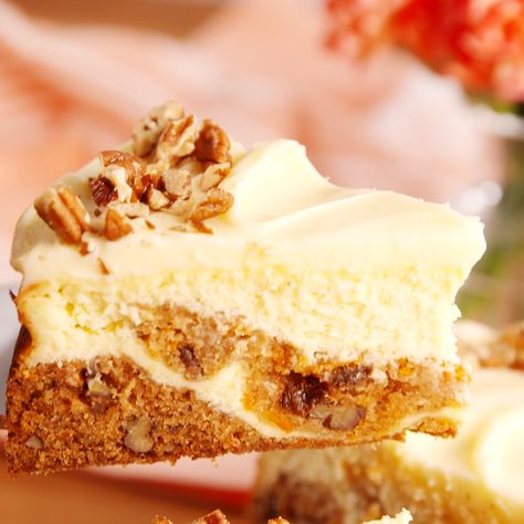 Half carrot cake, half plain cheesecake, this hybrid dessert is a slice of heaven. Get the recipe at Delish.com. #delish #easy #recipe #carrotcake #cheesecake #carrotcakecheesecake #raisins #pecans #easterrecipes #dessertrecipes #springrecipes