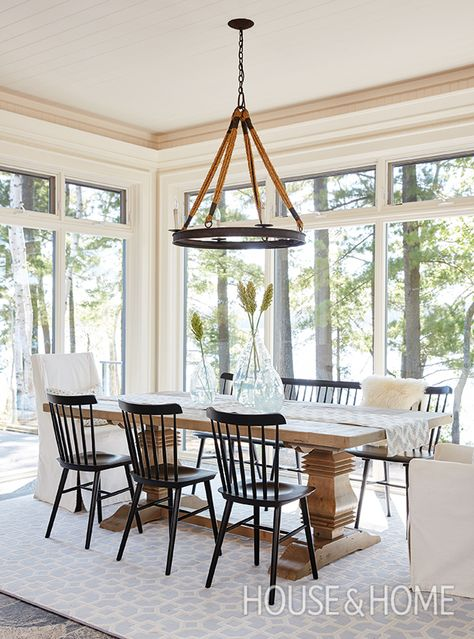 , modern farmhouse dining room with rustic farmhouse dining room table, rustic chandelier and black windsor dining room chairs, neutral farmhouse dining room Sunroom Dining, Cottage Dining Rooms, Dining Room Design, Living Room, Dining Room With Bench, Cottage Living, Dining Nook, Dining Room In Kitchen, Black Dining Room Table