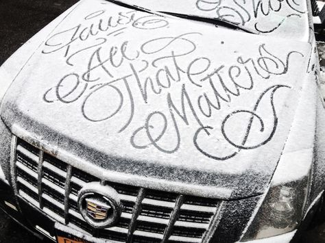 A graffiti artist named Faust creates elegant calligraphy messages on snowy parked cars in NYC.