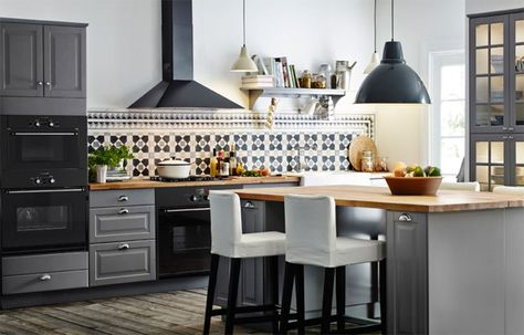 A well-planned kitchen complete with an island Love the gray ...