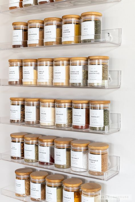This clever spice rack organization not only makes your kitchen more functional, but beautiful too! #spicerack #spiceorganization #organization #pantrygoals #pantryorganization