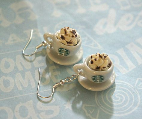 These earrings feature a pair of miniature Starbucks Coffee cups topped with whipped cream. Each miniature coffee cup measures cm in diameter and is securely attached to a silver tone hook.