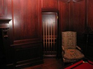 Secret door behind billiard cue rack